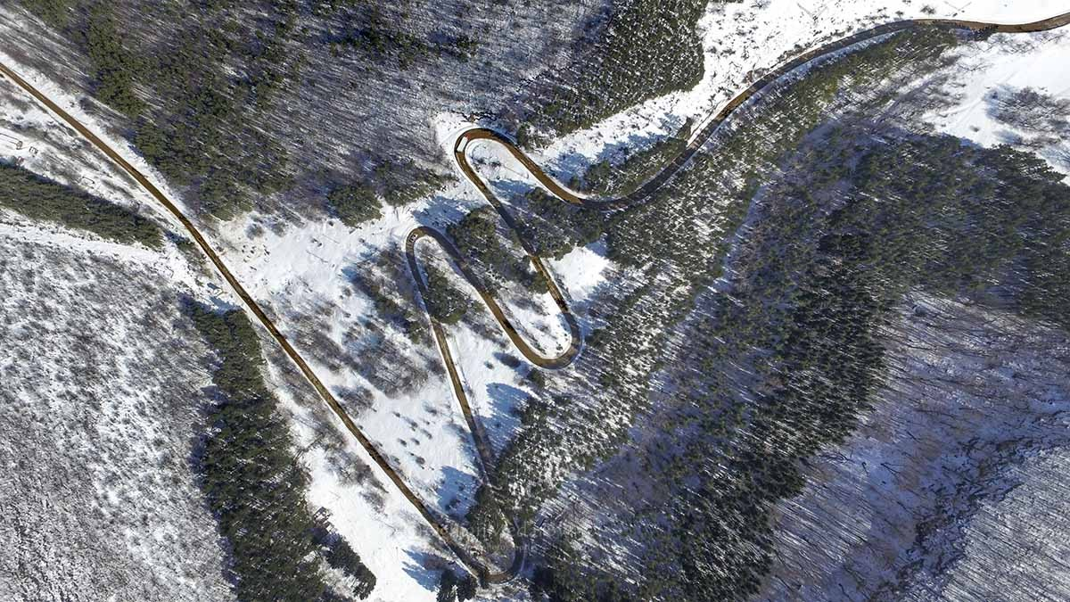 Meandering Mountain Road With Cars.jpg